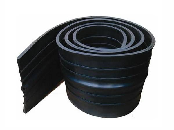 A coil of black TPV waterstop with center bulb