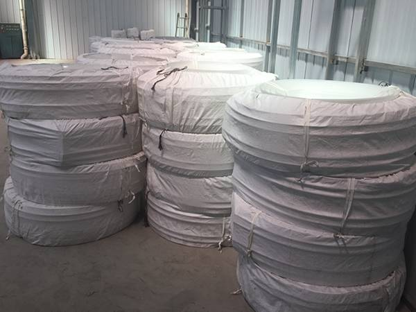 There are many rolls of white EVA waterstop packed in cloth bags.